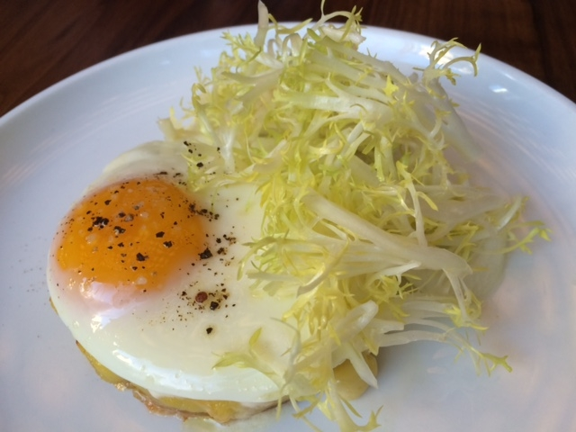 Lemon scented potato tart with truffled egg and frisee. An exciting ...